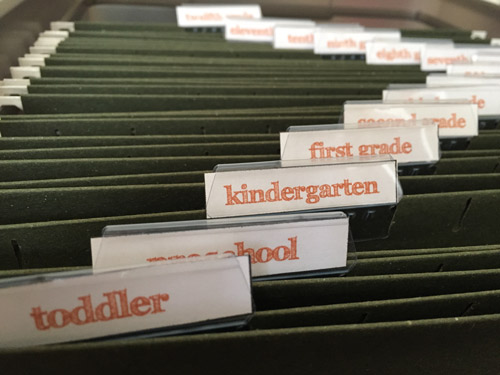A great way to create a school memory box and organize kids school papers once and for all-- from their toddler years through twelfth grade! What a great school keepsake to pass on to kids too!