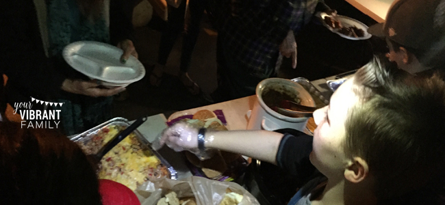 serving food to the homeless as part of a random acts of kindness challenge